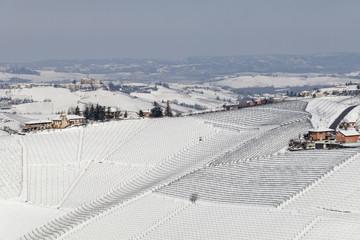Langhe, Cuneo district, Piedmont, Italy. Langhe wine region winter snow, Serralunga d'Alba castle