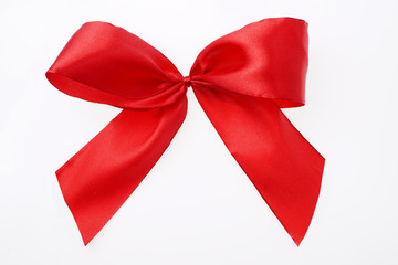 Red satin textile ribbon tied in bow Isolated on white