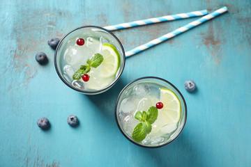 Glasses of fresh lemonade on table