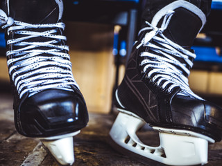close up hockey player ice skates in the locker room
