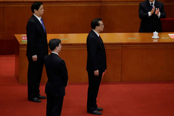 Chinese Premier Li Keqiang and newly elected Chairman of the Standing Committee of the NPC, Li Zhanshu, wait to drop their ballots during a vote at the sixth plenary session of the NPC in Beijing