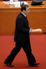 Yang Xiaodu, Deputy Secretary of the Central Commission for Discipline Inspection, walks to drop his ballot during a vote at the sixth plenary session of the National People's Congress (NPC) at the Great Hall of the People in Beijing