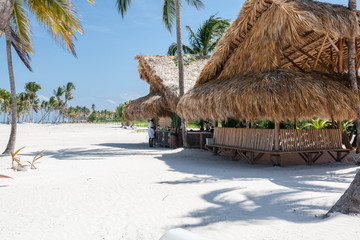 Beach Hut in the Caribbean Sea with White Sand, Turquoise Water and Palm Trees, in Cap Cana, Dominican Republic