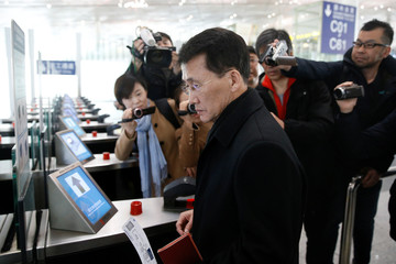 North Korean diplomat Choe Kang Il enters the departure area to board a flight to Helsinki at Capital International Airport in Beijing