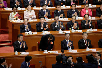 Chinese Premier Li Keqiang takes a bow after he is voted as the premier for another term, at the sixth plenary session of the National NPC at the Great Hall of the People in Beijing