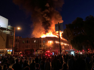 Fire consumes the top floor of a building in the North Beach neighborhood of San Francisco