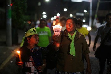 Catholics participate in a procession to commemorate the 38th anniversary of the murder of late Archbishop of San Salvador Oscar Arnulfo Romero in San Salvador