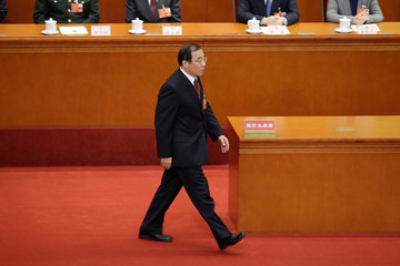 Newly elected head of the National Supervision Commission Yang Xiaodu walks to take the oath to the Constitution at the sixth plenary session of the NPC at the Great Hall of the People in Beijing