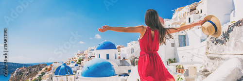 Wall mural Europe travel vacation fun summer woman feeling free dancing with arms open in freedom at Oia, Santorini, Greece island. Carefree girl tourist banner panorama.