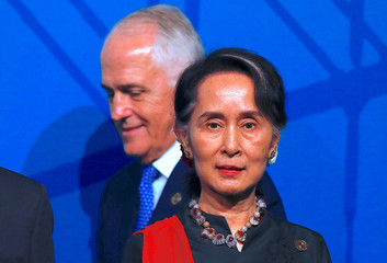 Australia's Prime Minister Malcolm Turnbull walks behind Myanmar's State Counsellor Aung San Suu Kyi during the Leaders Welcome and Family Photo at the one-off ASEAN summit in Sydney