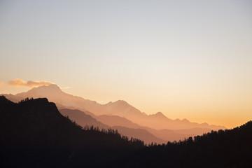 sunset throuh alpine mountin layers