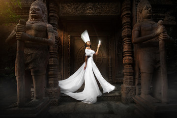 Fairytale picture.White Queen hold white crystal in dramatic Palace place
