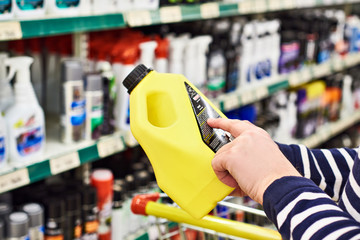 Man buyer chooses liquid foam car wash in store