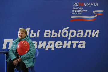 A woman visits a polling station during the presidential election in Moscow