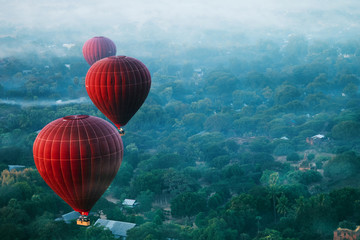 Poster Montgolfière / Dirigeable Red balls in the morning in the fog above Bagan. Bagan is an ancient city located in the Mandalay Region of Myanmar