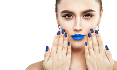 Female Face with Makeup Isolated on White Background. Blue Lips and Nails Closeup. Beauty Concept