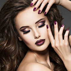 Spoed Fotobehang Beauty Beautiful face of woman with maroon makeup.