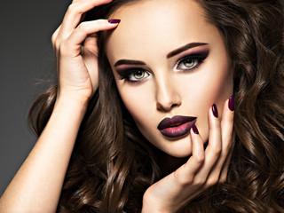 Foto op Plexiglas Beauty Beautiful face of sensual woman with maroon makeup.