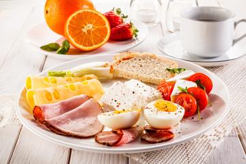 English breakfast on wooden table