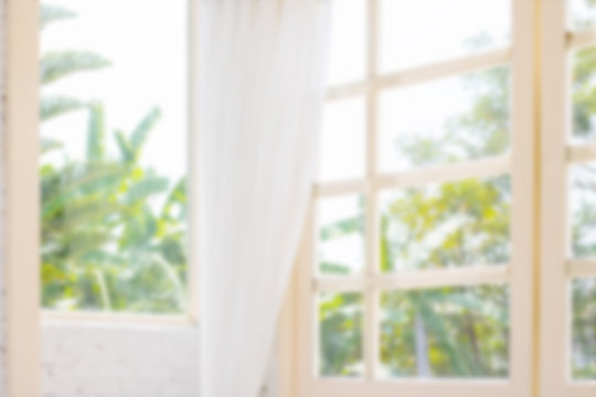 Defocused window background with white curtains in morning time.