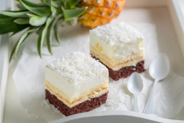 Tasty white cake with pineapple and coconut