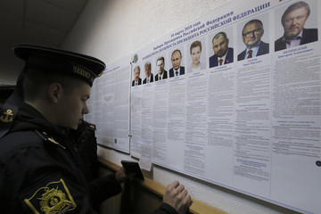 Russian navy sailors visit a polling station during the Russian presidential election in Sevastopol