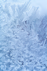 Frosty pattern on the glass window. Abstract, background, texture