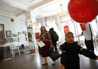 People visit a polling station during the presidential election in Moscow