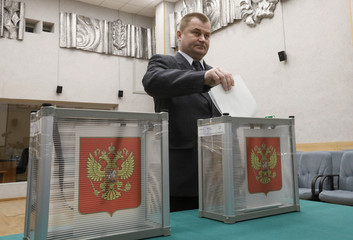 Roscosmos cosmonaut Ovchinin casts a ballot at a polling station during the Russian presidential election in Baikonur