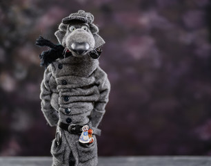 Woolen doll gray wolf coat cap scarf detective smoking pipe