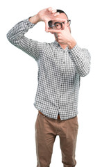 Happy young man doing a gesture of frame with his hands