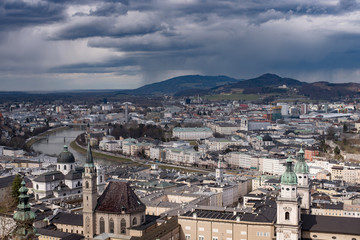 Winter skyline of Salzburg at the background of high mountains Alps, view from above. Austria, Salzburg city, Europe.