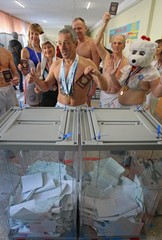 Members of a local winter swimming club visit a polling station during the presidential election in Barnaul