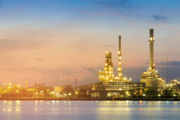 Night view over Oil refinery river front, industrial background