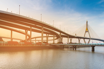 Sunset over Suspension Bridged and Highway interconnection riverfront, Bangkok Thailand