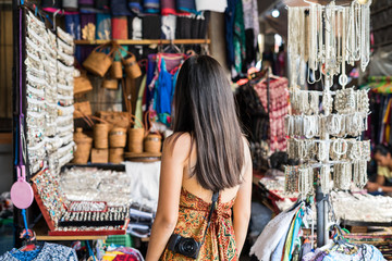 Young woman traveler at ubud market in bali