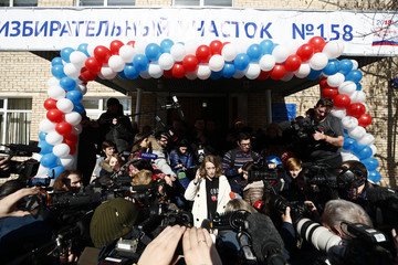 Presidential candidate Sobchak addresses the media after visiting a polling station during the presidential election in Moscow