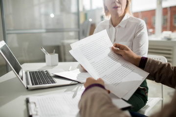 Business contract in male hands with woman sitting in the background
