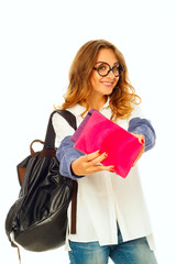 Pretty smiley student with book wearing glasses over white background