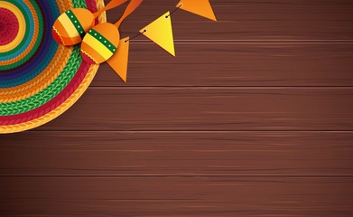 Mexican holiday background. Sombrero, maracas on brown wooden background. Top view. Vector illustration