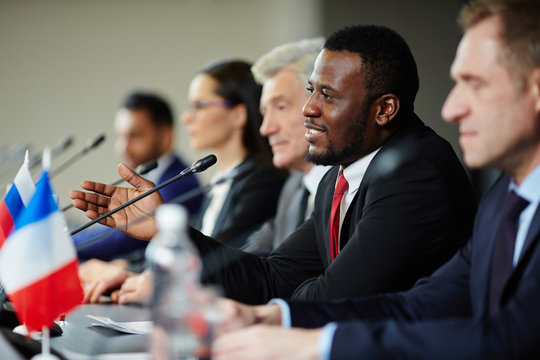 Young African-american politician explaining his opinion to audience during conference