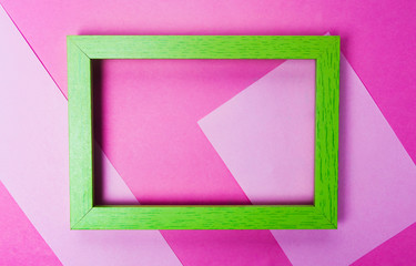 Green photo frame on pink background