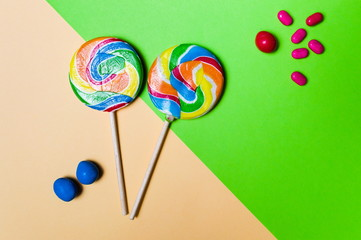 Lollipop candies on colorful background