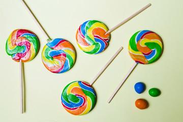 Lollipop candies on yellow background