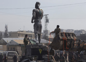Turkish-backed Free Syrian Army members pull down Kurdish statue in the center of Afrin