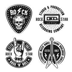 Set of four rock n roll music vector emblems, labels, badges and logos in vintage style on white