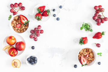 Breakfast with muesli, fruits on white background. Healthy food concept. Flat lay, top view, copy space