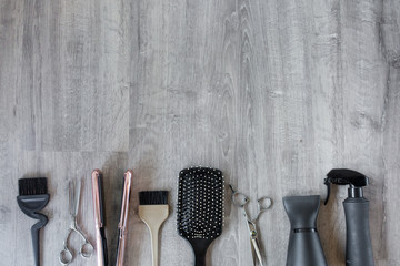 Hair Salon Accessories on a Wood Background