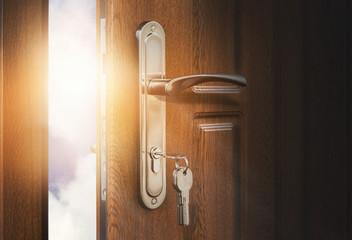 Open wooden doors with sky background