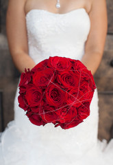 Bride Holding Bouquet of Red Roses